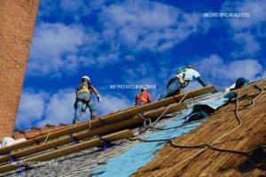 Roofers on a roof in Brooklyn
